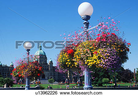 Stock Images of Flower baskets hanging from lamp posts with the.