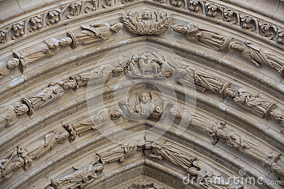 Notre Dame Tympanum And Archivolts Stock Photo.