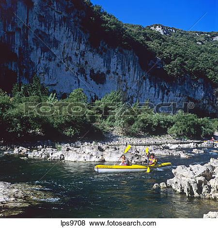 Pictures of YOUNG COUPLE CANOEING ON RIVER GORGES DE L'ARDECHE.