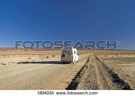 Stock Photo of camper van on a desert road on the altiplano of.
