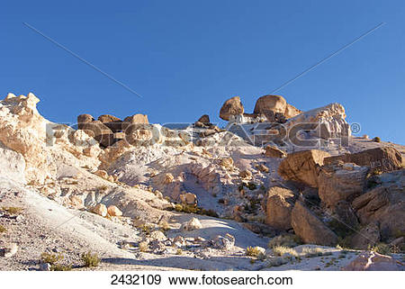 Stock Photograph of Colourful desert rock formation in late.