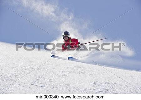 Stock Photography of Austria, Zuers, Young man doing telemark.