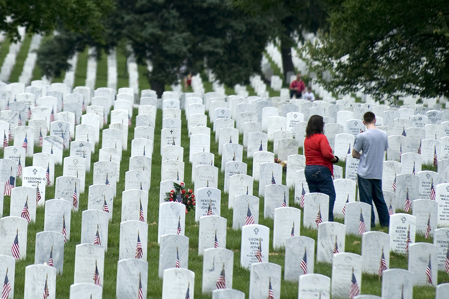 Stock Photo of People Visiting a Military Gravesite at Arlington.