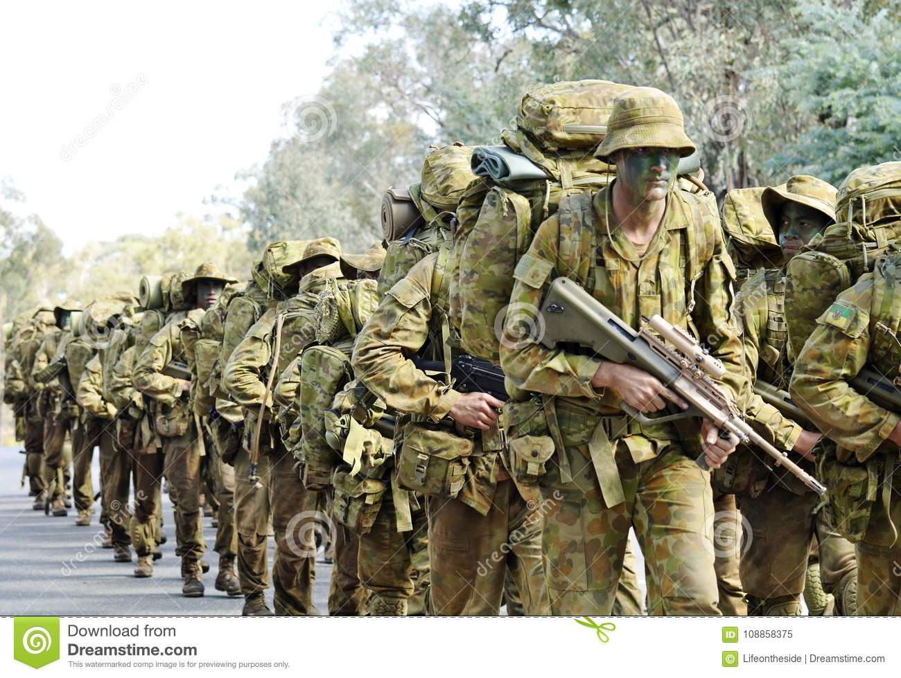 Australian Army Soldiers Marching Road To Base In Camouflage.