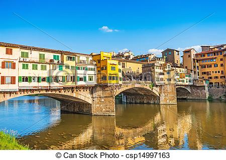 Stock Image of Famous Ponte Vecchio with river Arno at sunset in.