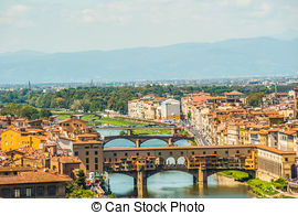 Stock Photography of Pone Vecchio over Arno river in Florence.