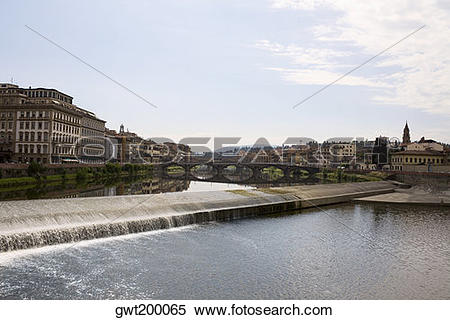 Stock Image of Arch bridge across a river, Arno River, Florence.