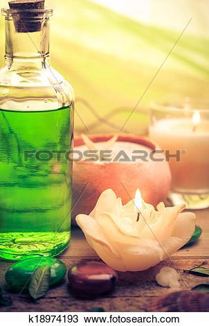 Stock Photo of Oil massage aromatic candles stones Zen k18974193.