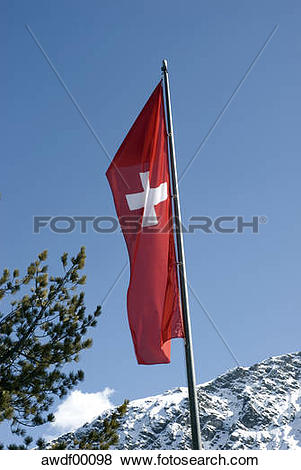 Pictures of Switzerland, Arosa, Swiss flag on flag pole under blue.