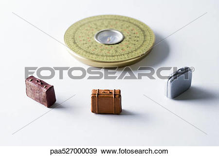 Stock Photograph of Miniature suitcases arranged around Feng Shui.