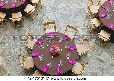 Picture of Folding Chairs Arranged Around Circular Dining Tables.
