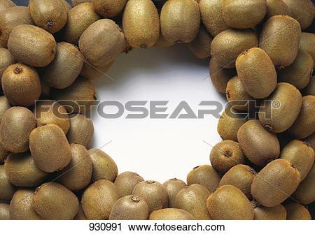 Stock Photography of Lots of whole kiwi fruits, arranged around.