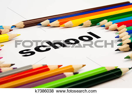 Pictures of many colored pencils arranged around the word school.