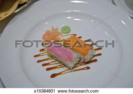 Stock Photography of Fish appetizer artfully served on white plate.