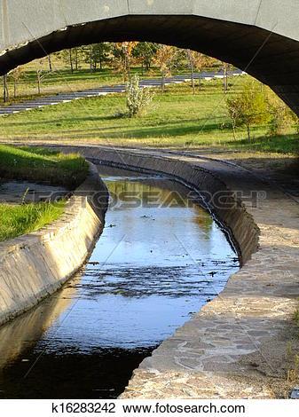 Stock Photo of An artificial brook under a bridge k16283242.