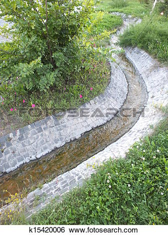 Stock Images of An artificial brook in the park k15420006.