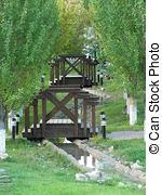 Picture of An artificial brook with a bridge in the park.