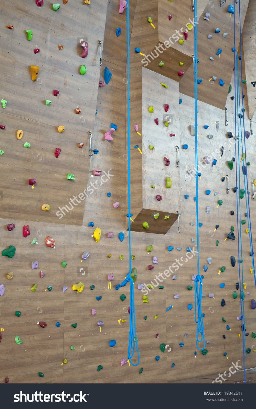 Grungy Surface Of An Artificial Rock Climbing Wall With Toe And.