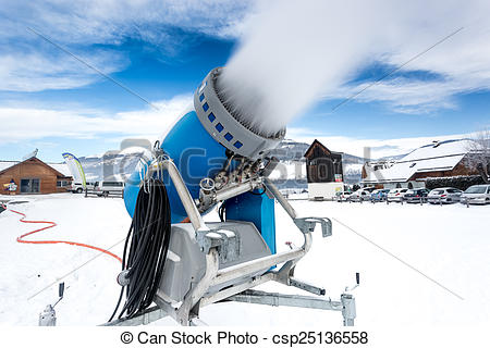 Stock Images of snow cannon making artificial snow at cold on ski.
