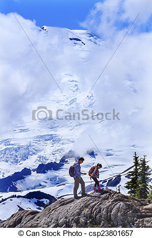 Stock Images of Asians Hiking Mount Baker Under Clouds from Artist.