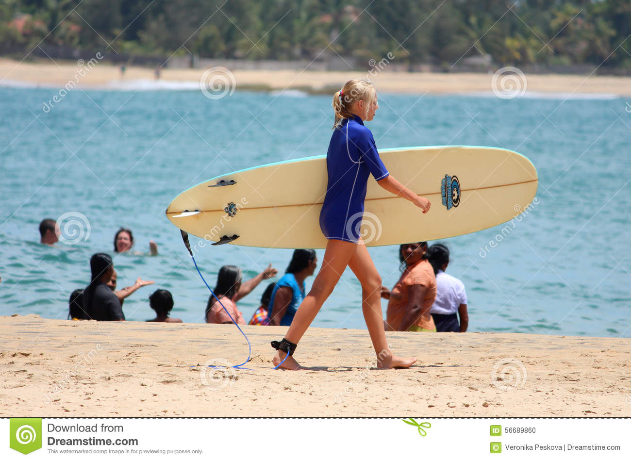 ARUGAM BAY, 12 AUGUST: Young Girl Goes Surfing Editorial Image.