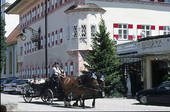 Stock Photograph of Two people on horse drawn carriage, Aschau.