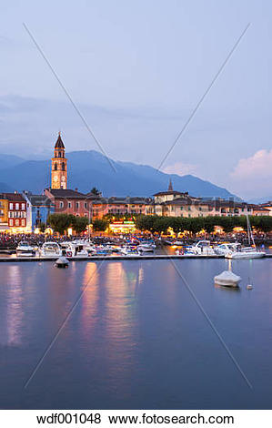 Pictures of Switzerland, Ticino, View of Ascona at dusk with boats.