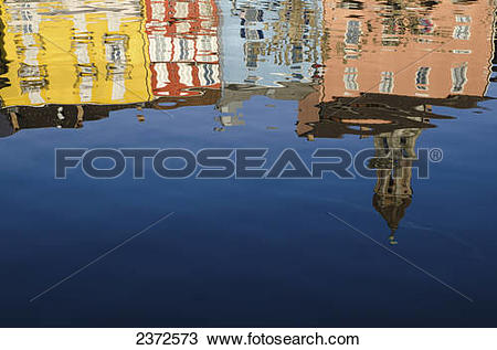 Stock Photo of Reflection Of Colourful Buildings In Lake Maggiore.