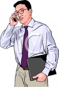 An Asian Businessman Talking on a Cellphone.