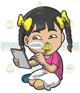 An Asian Girl Drawing Something On Her Mobile Tablet.