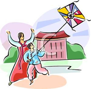 An Asian Mother and Son Flying a Kite.