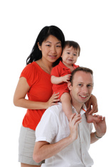 Caucasian Father and Asian Mother With Baby Girl Stock.