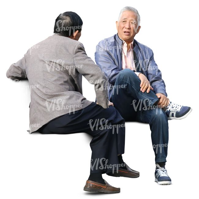 Two older asian men sitting and talking.