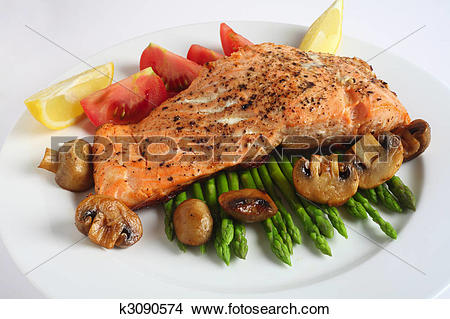 Stock Photo of Salmon steak dinner with mushroom, asparagus.