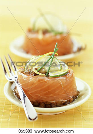 Stock Photo of Pickled salmon aspic jelly with green lentils.