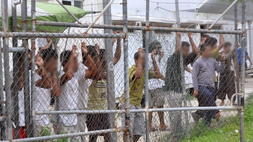 Australia to pay compensation to PNG asylum seekers.