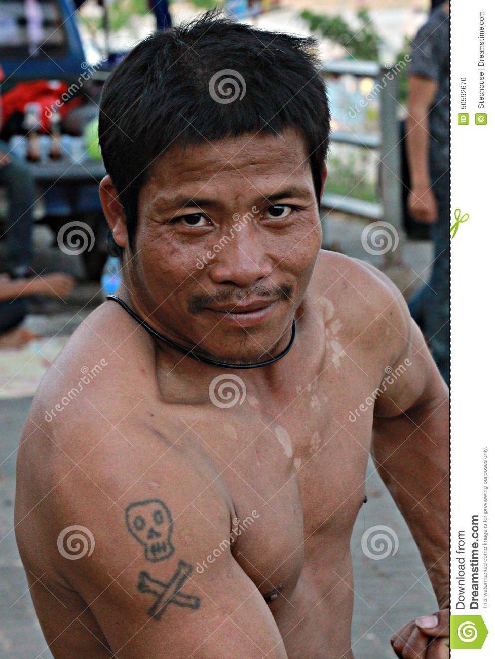 Man With Tattoo Poses On The Mekong, Chiang Khong, Thailand.