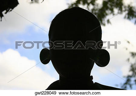 Stock Photograph of Silhouette of a statue, Chiang Khong, Thailand.
