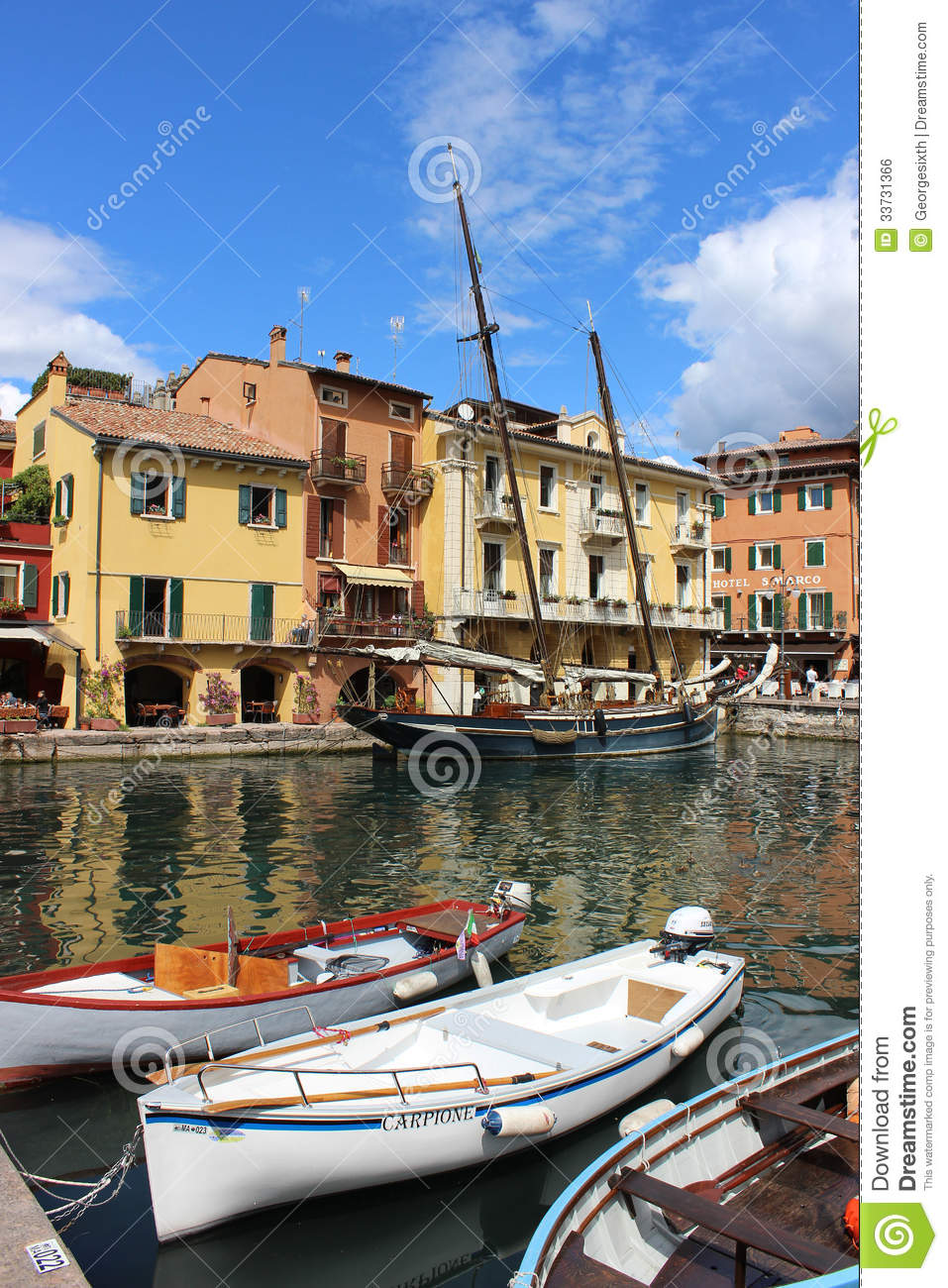 Boats In Harbor At Malcesine On Lake Garda, Italy Editorial Photo.