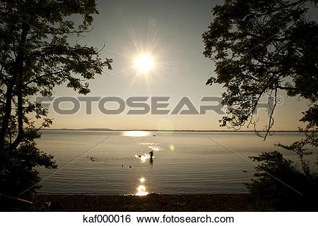 Stock Images of Germany, Bavaria, People bathing in Lake Chiemsee.