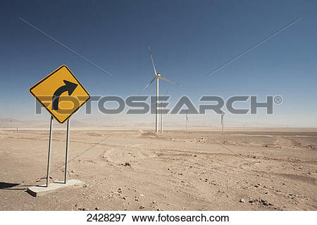 Picture of Wind turbines in the Atacama desert with a yellow sign.