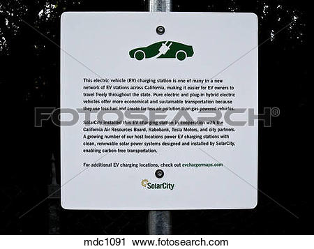 Stock Photography of Charging station sign for electric vehicles.