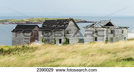 Stock Photograph of Broken and abandoned wooden houses along the.