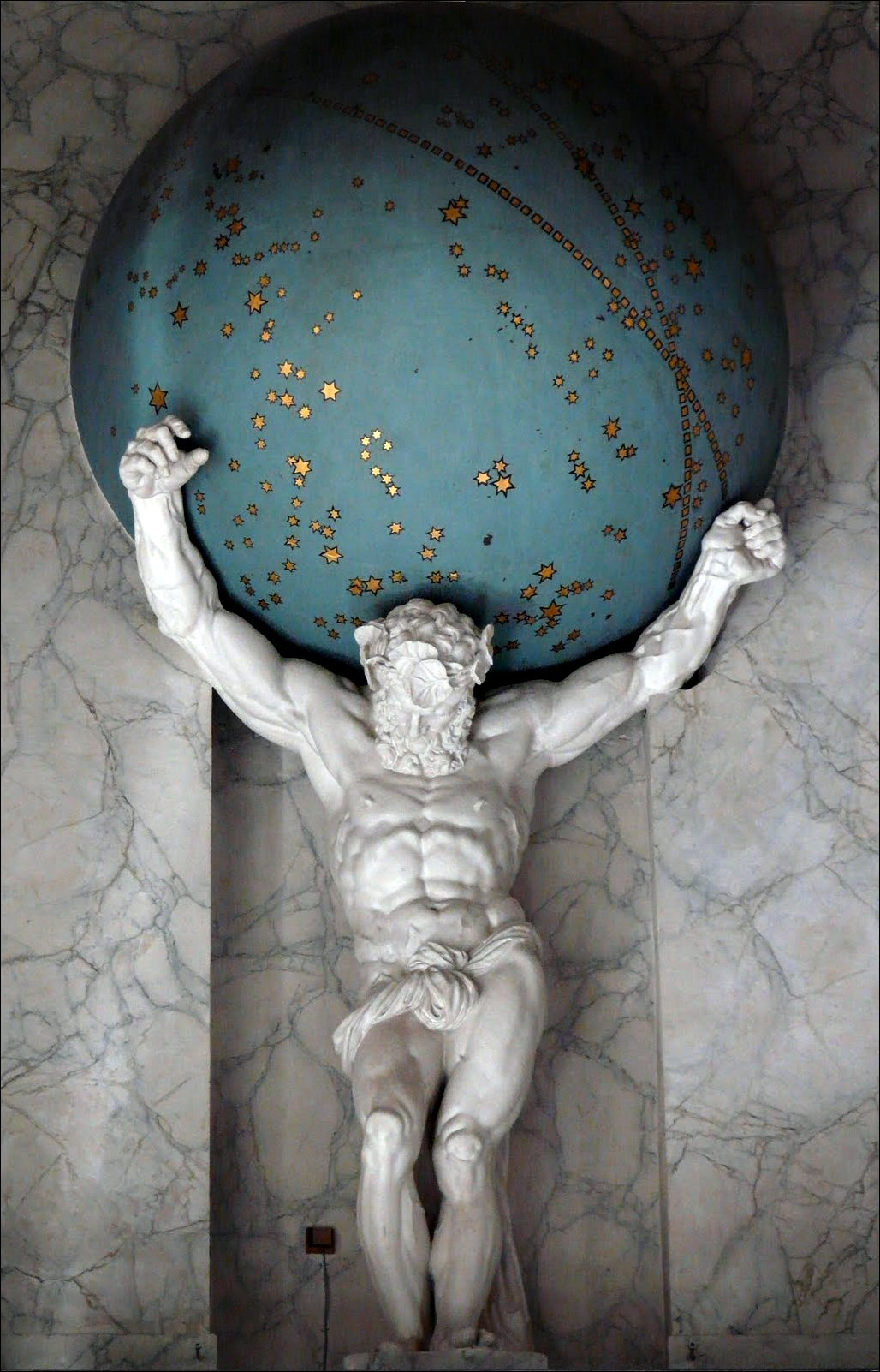 Atlas holding up a celestial map (Royal Palace in Amsterdam.