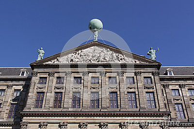 Statue Of Atlas On The Royal Palace In Amsterdam Royalty Free.