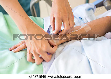 Stock Images of Female Nurse Attaching IV Drip On Male Patient's.