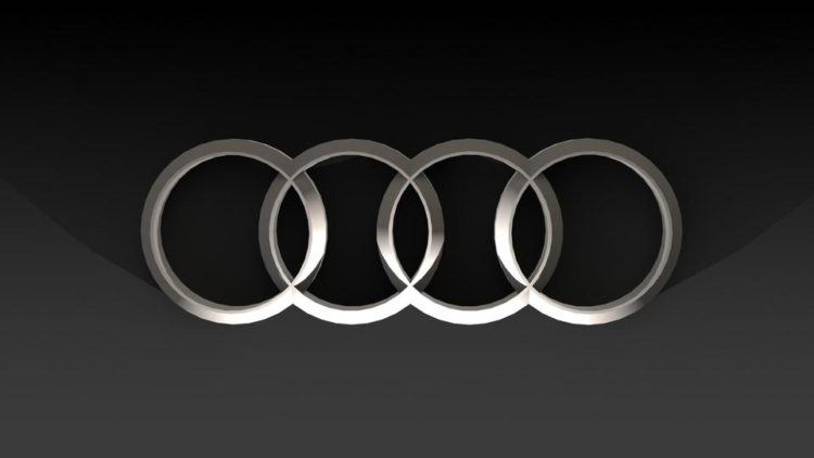 The History of and Story Behind the Audi Logo.