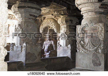 Stock Photography of Statue carved in a cave, Ellora, Aurangabad.