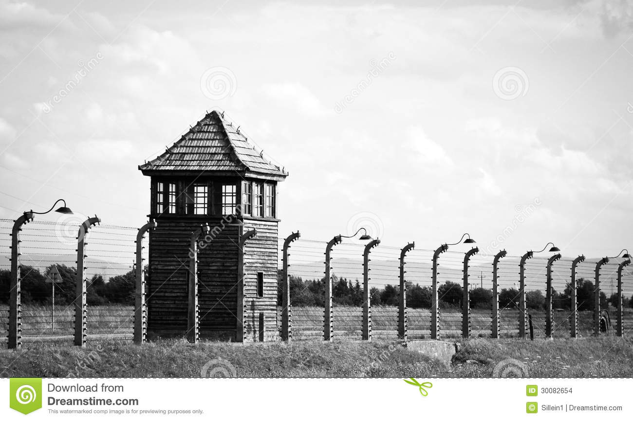 Fence And Watch Tower In Auschwitz Concentration Camp Editorial.