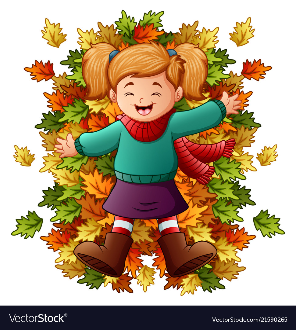 Happy little girl playing with autumn leaves.